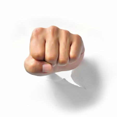 Fist punching paper isolated on white background  photo