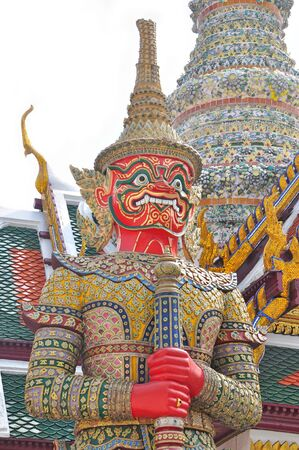 giant stands in the temple of the emerald buddha, Bangkok Thailand  photo
