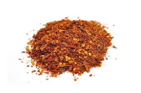crushed red peppers: dried and crushed red peppers on white background