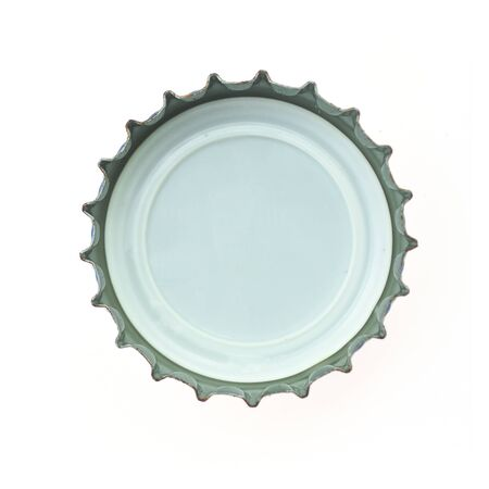 bottle opener: bottle cap on white background