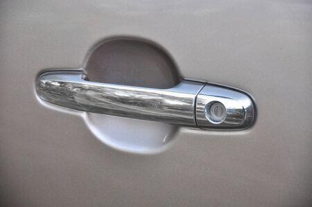 Handle of a silver car door Stock Photo - 16802776