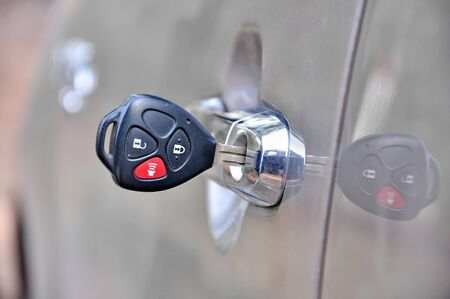 Door of the car with prickly in the lock. Stock Photo - 16802774