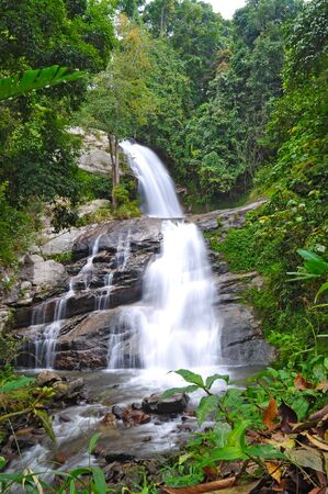 Deep forest Waterfall in Chiangmai, Thailand  photo