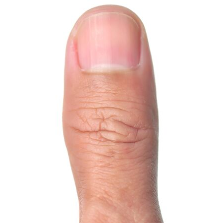 body curve: Macro view of a thumb finger over a white background. Stock Photo