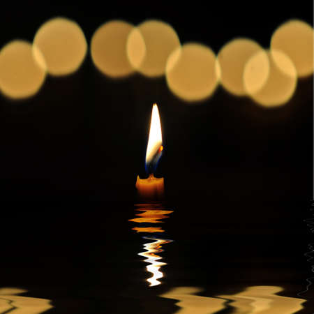 Flame to light a candle in the dark ,in water photo