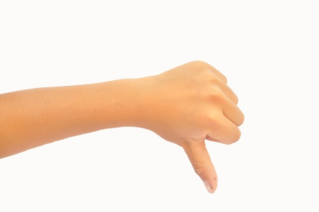 Thumb down boy hand sign isolated on a white background  Stock Photo - 18290378