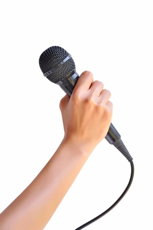 Woman hand with microphone isolated on white background  Stock Photo - 18624295
