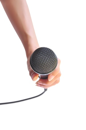 Woman hand with microphone isolated on white background Stock Photo - 18624279