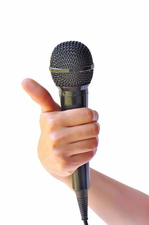 Woman hand with microphone isolated on white background Stock Photo - 18624301