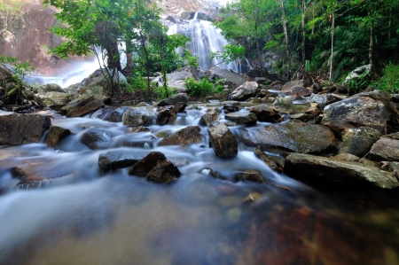 Flowing mountain stream with stones  photo