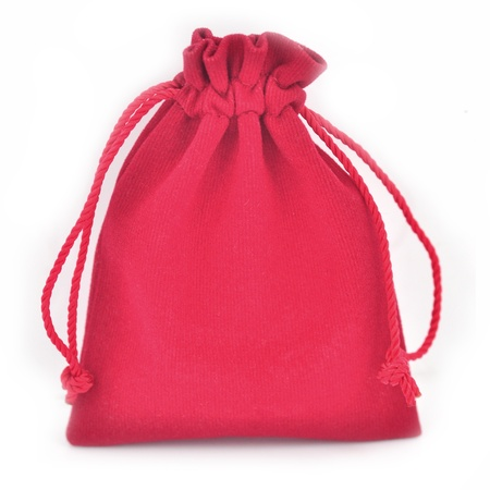 Red velvet bag isolated on white background photo
