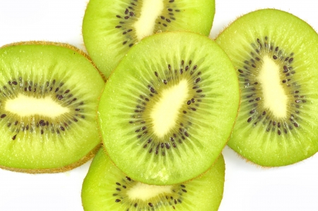 slices of kiwi fruit on white background photo
