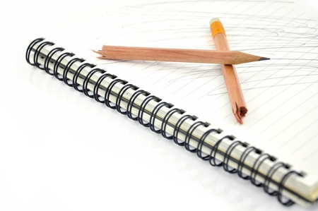 stress testing: Broken pencil on notebook