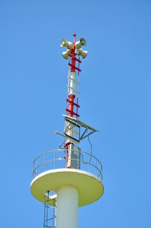 soundsystem: Speaker on high tower and blue sky  Stock Photo