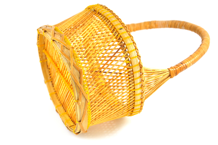Yellow wicker basket isolated on white background Stock Photo - 23022731