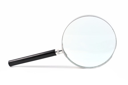 Magnifying glass isolated on white  photo