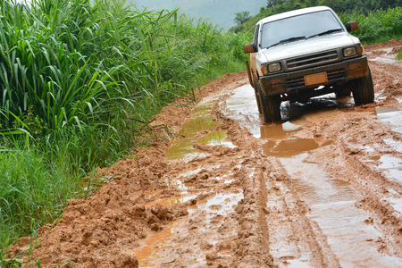 Car in mud in the road photo