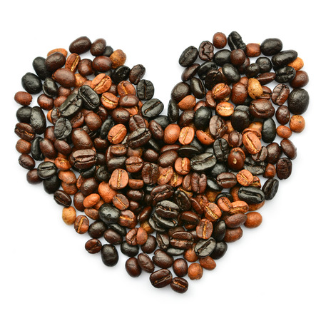heart from coffee beans isolated on a white background  photo