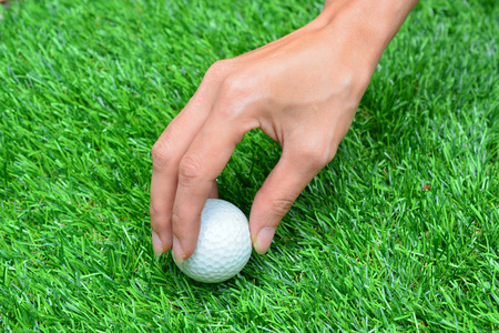 deportes: Taking the ball out of green grass Stock Photo