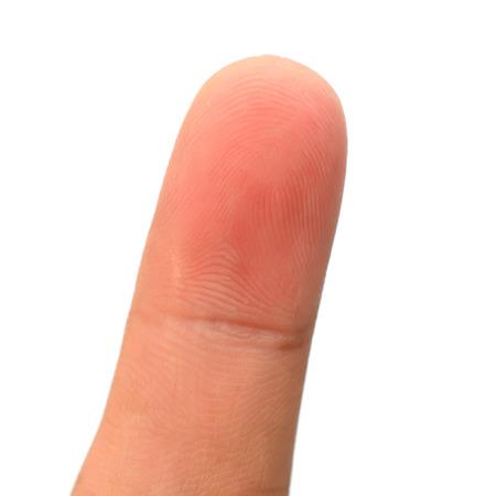 dedo meÑique: Primer meñique, el dedo aislado en el fondo blanco Foto de archivo