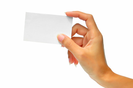 Close-up of an empty business card in a womans hand isolated on white Zdjęcie Seryjne