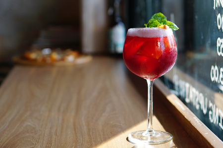 A Glass of Red Sangria, Homemade cocktail traditionally consists of red wine and chopped fruit, often with other ingredients such as cherry liqueur, Triple sec, Red Wine, Grapefruit juice and syrup.