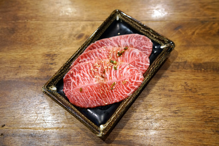 Wagyu flat iron - Premium raw thin sliced beef, Prepared for Japanese barbecue style also know as Yakiniku. Banco de Imagens