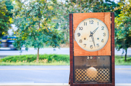past midnight: old clock on nature background Stock Photo