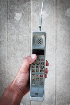 old cell phone: Old mobile phone using by man hand