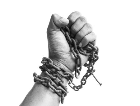 clench: Male hand clench ones hand hole chain. business concept