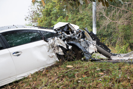 Accident car crash with tree on the road