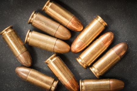 white metal: 9mm bullet for a gun (dark style)