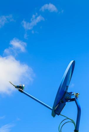 airwaves: satellite dish on sky background