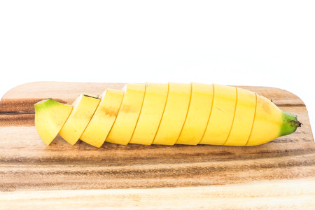 banana slice: banana slice put on wood on white background
