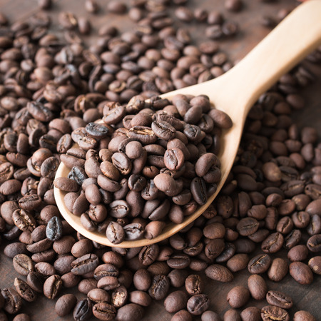 wooden spoon with coffee beans photo