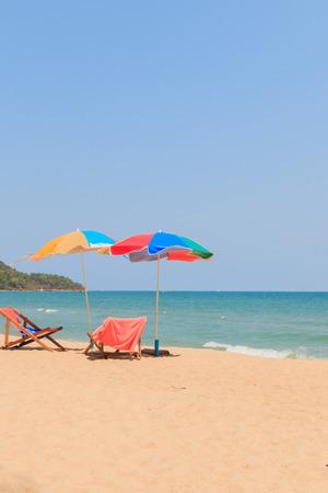 longue: Beach chair and umbrella on sand beach