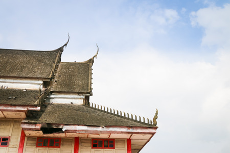 Temple roof in Thailand on blue-sky background. photo