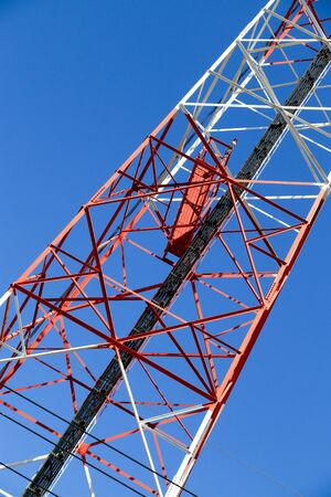 telephone mast: Close up cellular pillar with blue sky background.
