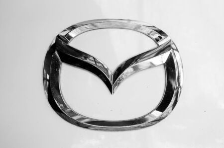 mazda: BANGKOKTHAILAND  April 112015 : Logo of the brand Mazda on white car