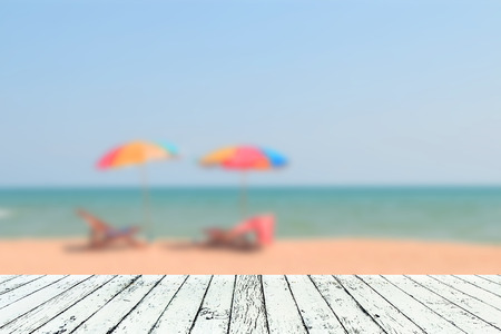Image of blurred sea blue-sky and colorful umbrella with  wooden plank under image Reklamní fotografie