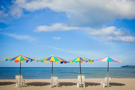 peaceful scene: Beach chair and umbrella on sand beach