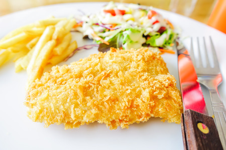chicken chop: chicken chop, French fries and vegetables salad