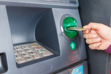 pincode: ATM close-up with woman hand Stock Photo