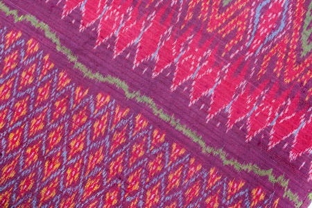 red carpet background: Colorful thai silk handcraft textile texture or background