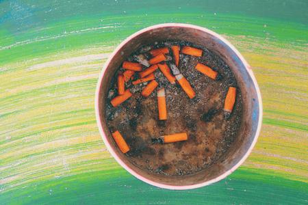 ashtray: Bad addiction. Ashtray and cigarettes close-up.