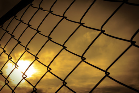 tillable: seamlessly tillable chain link fence with park in background Stock Photo