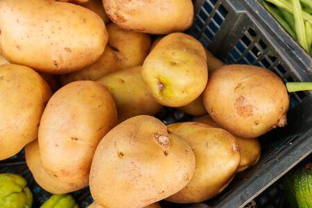 merchandiser: Display with fresh potatoes  fresh potatoes  Potatoes Stock Photo