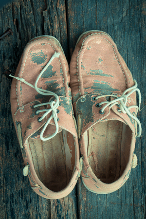 loafers: Old brown shoes on wooden background vintage tone style.