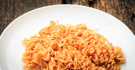 sev: Noodle on white plate put on old wooden table Stock Photo