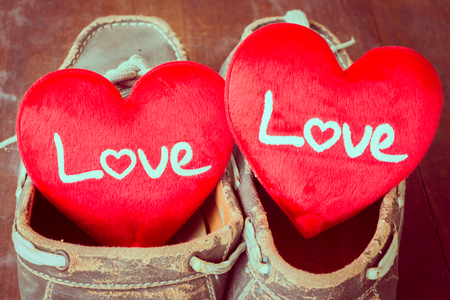 old shoes: Love sign in old shoes, valentine day.